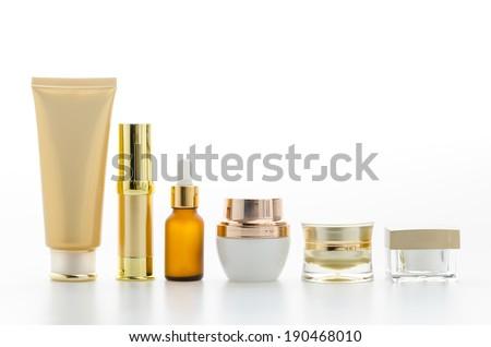 Cosmetics bottle isolated on white - stock photo