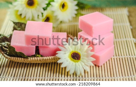 cosmetics bottles, soap and towels spa - stock photo