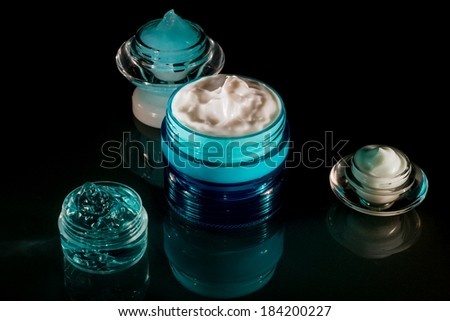 Cosmetics - Cream and gel in various cosmetic containers, jars