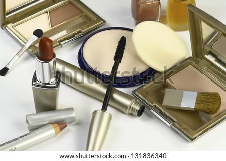 Cosmetics, eyeshadow, lipstick, nail polish, eye liner - stock photo