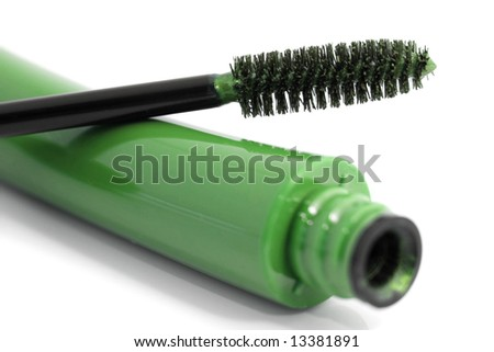 Cosmetics: green mascara, isolated on white
