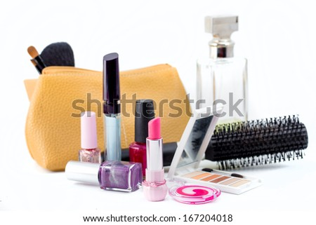 cosmetics isolated on white background. Pink lipstick, mascara,