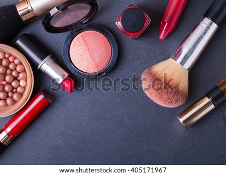 Cosmetics on black background, top view