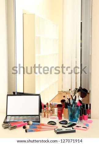 cosmetics on table near mirrow - stock photo
