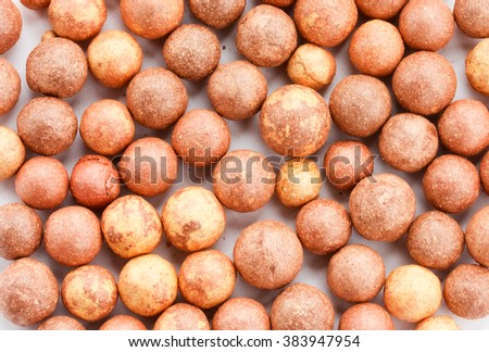 Cosmetics rouge balls close up background - stock photo
