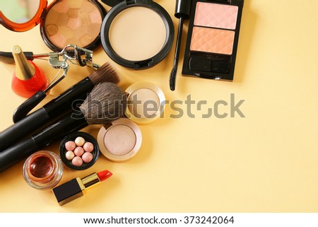 cosmetics set for make-up (face powder, lipstick, mascara brush, nail polish, blush, eye shadow) - stock photo
