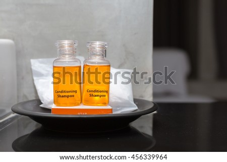 Cosmetics set on black plate in hotel room ,Set for care of a body.