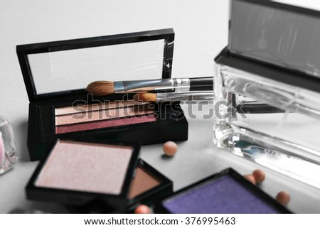 Cosmetics set on turquoise background