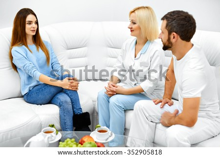Cosmetology. Beautiful Young Healthy Caucasian Woman Patient Having Consultation With Cosmetician In Medical Clinic. Healthcare, Medicine Concept. Body, Skin Care. - stock photo