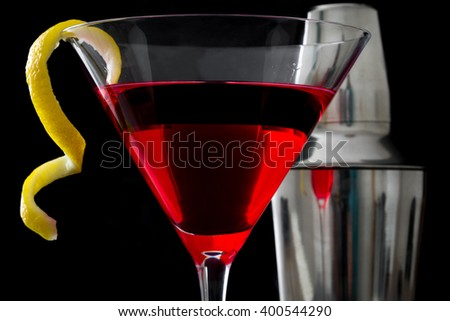 Cosmopolitan cocktail and shaker on black background  - stock photo
