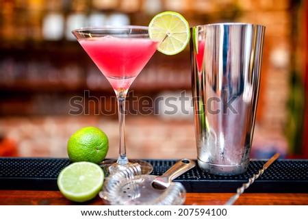 cosmopolitan cocktail drink at casino and bar served with lime and ice - stock photo