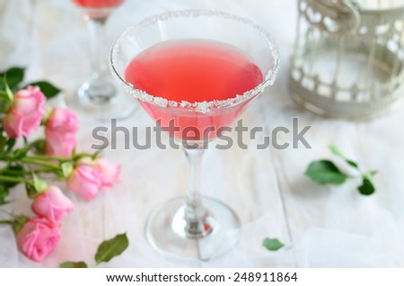Cosmopolitan cocktail on romantic white background, horizontal - stock photo