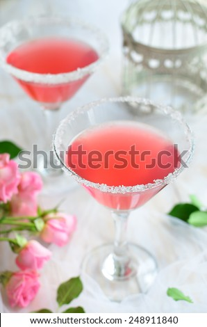 Cosmopolitan cocktail on romantic  white background, vertical - stock photo