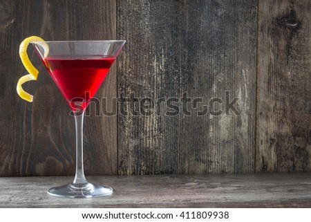 Cosmopolitan cocktail on wood background  - stock photo