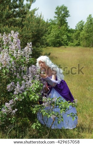 Cosplay scene / (Amalthea at Lilac Tree)  - stock photo