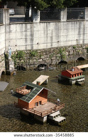 Cossirano (Bs),Lombardy,Italy, some wooden  houses built for the ducks in a little river