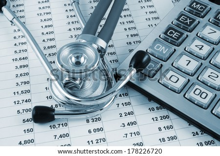 Cost of health care concept, stethoscope and calculator on document - stock photo