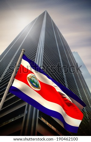 Costa rica national flag against low angle view of skyscraper
