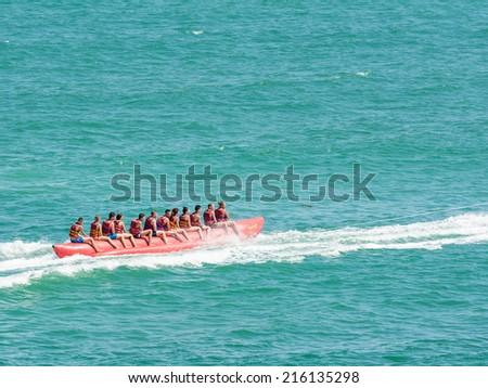 COSTINESTI, ROMANIA - JULY 30, 2014: People Having Fun On Banana Trip On The Black Sea Beach In Costinesti Holiday Resort. - stock photo