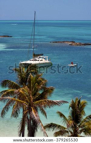costline boat catamaran in the  blue lagoon relax  of isla contoy  mexico - stock photo