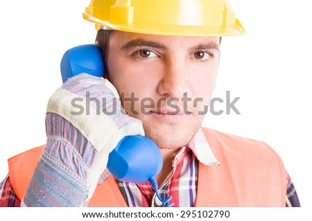 Costruction worker or builder talking on the phone classic telephone - stock photo