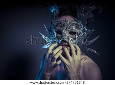 Costume, bearded man with silver mask Venetian style. Mystery and renaissance - stock photo