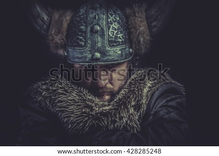 Costume, Viking warrior with a huge sword and helmet with horns - stock photo