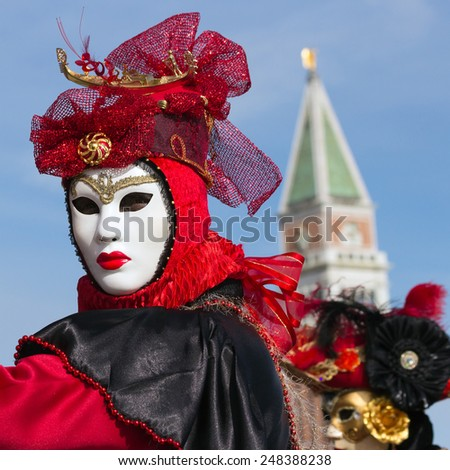 Costumed woman during Carnival in Venice - stock photo