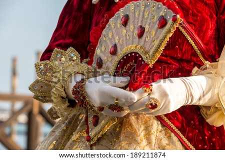 Costumed woman during venetian carnival, Venice, Italy - stock photo