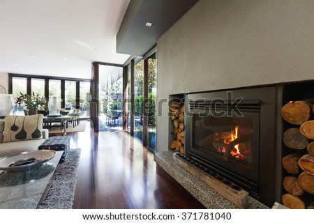 Cosy gas log fire in architect designed modern luxury open plan family home - stock photo