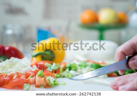 Cosy kitchen interior with fresh vegetables on table
