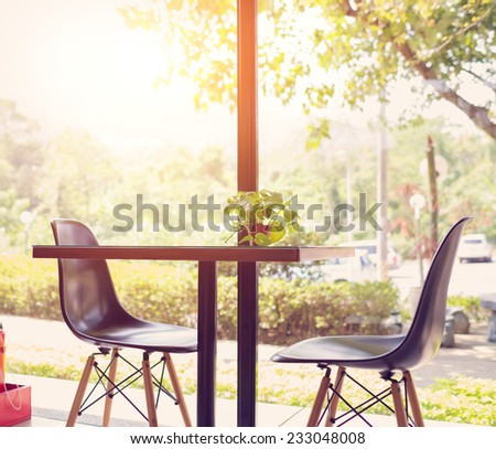 Cosy table and two chairs beside window with great view - stock photo