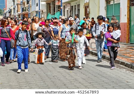 COTACACHI, ECUADOR - JUNE 23, 2016: Children parade on the first day of Inti Raymi, the Quechua solstice celebration.  Young children march with their parents