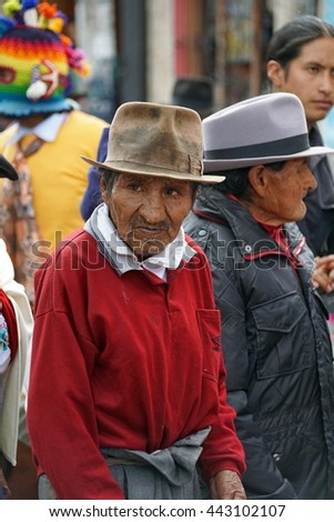 COTACACHI, ECUADOR - JUNE 23, 2016: Children's parade for Inti Raymi, the Quechua solstice celebration.  Elderly men in traditional dress parade with a senior group, in the procession.