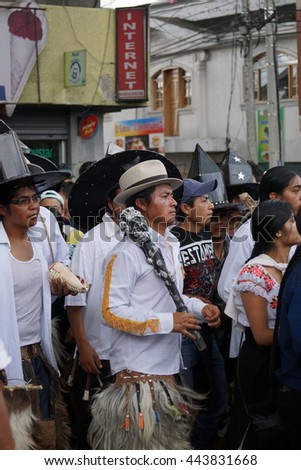 COTACACHI, ECUADOR - JUNE 25, 2016: Inti Raymi, the Quechua solstice celebration, with a history of violence in Cotacachi.  Men stomp and dance in the square to wake up Mother Earth.