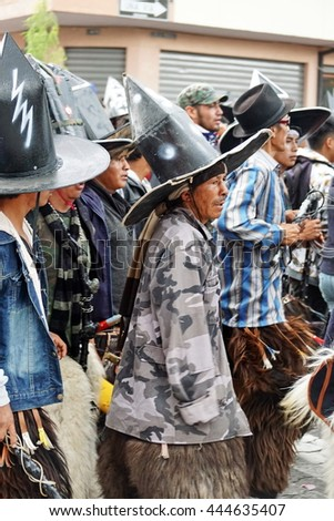 "COTACACHI, ECUADOR - JUNE 25, 2016: Inti Raymi, the Quechua solstice celebration, with a history of violence in Cotacachi.  Men stomp and march forward to ""take the square."""
