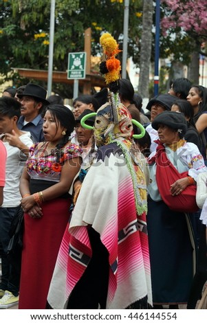 COTACACHI, ECUADOR - JUNE 30, 2016: Inti Raymi, the Quechua solstice celebration, with a history of violence in Cotacachi.  A man in an antique devil mask and wool poncho participates in the dance.