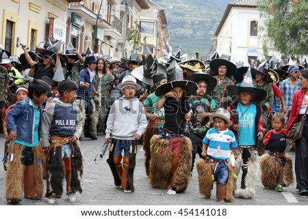 COTACACHI, ECUADOR - JUNE 30, 2016: Inti Raymi, the Quechua solstice celebration, with a history of violence in Cotacachi.  Children parade ahead of the men.