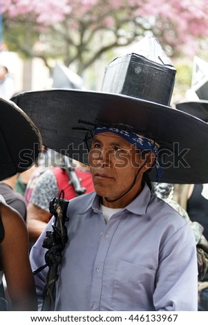 COTACACHI, ECUADOR - JUNE 30, 2016: Inti Raymi, the Quechua solstice festival, with a history of violence in Cotacachi.  Costumed men stomp and dance in the square to awaken Mother Earth.
