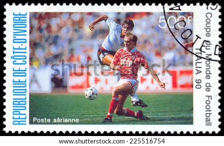 COTE D'IVOIRE - CIRCA 1990: A stamp printed in COTE D'IVOIRE shows Soccer, England and USSR, World Cup Soccer Championships in Italy  circa 1990 - stock photo