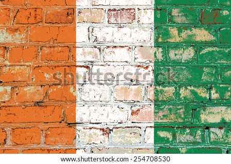 Cote d'Ivoire flag painted on old brick wall texture background - stock photo