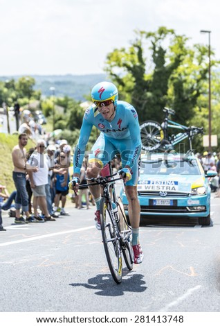 COTE DE COULOUNIEIX-CHAMIERS,FRANCE - JULY 26:Lieuwe Westra (Astana Team) pedaling  on a steep slope,during the stage 20 ( time trial Bergerac - Perigueux) of Le Tour de France on July 26, 2014  - stock photo