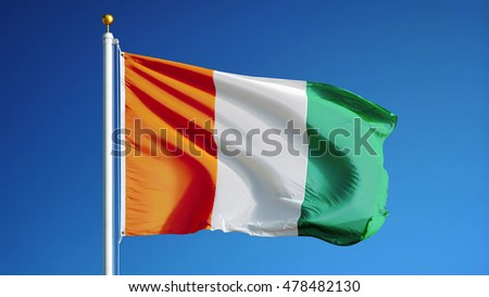 Cote Ivoire flag waving against clean blue sky, close up, isolated with clipping path mask alpha channel transparency