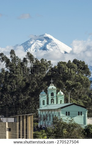 Cotopaxi volcano over the San Jaloma Church and Village, De Los Chillos Valley, Andean Highlands of Ecuador, South America - stock photo