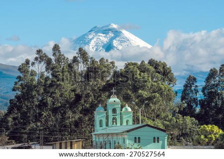 Cotopaxi volcano over the San Jaloma Church and Village, De Los Chillos Valley, Andean Highlands of Ecuador, South America - stock photo