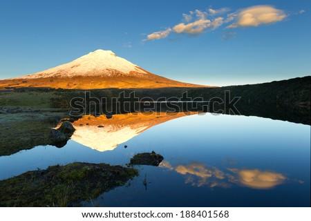 Cotopaxi volcano refelcting in Santo Domingo laguna - stock photo