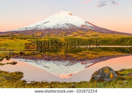Cotopaxi Volcano Reflecting In Santo Domingo Laguna - stock photo