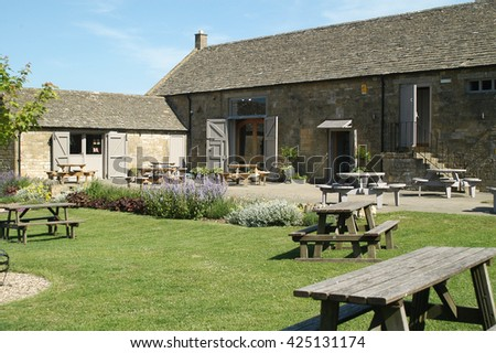 Cotswold cottages, backyard during summer - stock photo