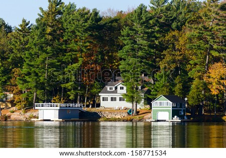 Cottage and a boathouse - stock photo