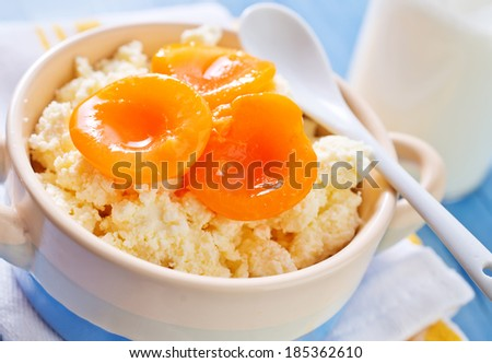 cottage and apricots - stock photo